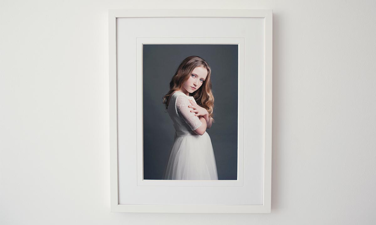 Photograph of young girl in frame